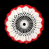 Isolated crocheted decorative white doily with red border on a black background. Round volumetric doily stock image