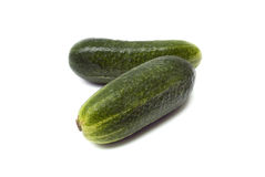Isolated cucumber. Two fresh cucumbers isolated over white background stock images
