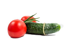Isolated cucumber with condom Royalty Free Stock Photography