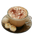 Isolated cup of capuccino and two coconut candies royalty free stock image