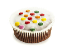 Isolated cupcake decorated with smarties Royalty Free Stock Image