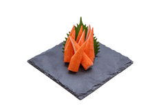 Isolated Cut Kani Crab Stick Sashimi Served with Sliced Radish on Stone Plate Stock Image