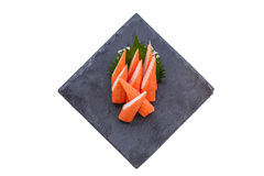Isolated Cut Kani Crab Stick Sashimi Served with Sliced Radish on Stone Plate Royalty Free Stock Photography