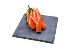 Isolated Cut Kani Crab Stick Sashimi Served with Sliced Radish on Stone Plate Royalty Free Stock Images