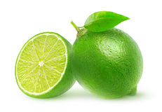 Isolated cut limes. One and a half lime fruit isolated on white background with clipping path Royalty Free Stock Photos