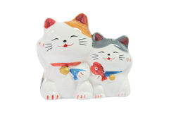 2 cute japanese cat dolls. Isolated 2 cute shiny ceramic japanese cat dolls royalty free stock images