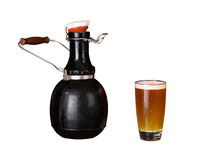 Isolated cutout of growler and glass of beer Stock Photos