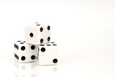 Isolated Dice. Three stacked die isolated on white background Stock Image