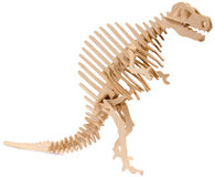 Isolated dinosaur made of plywood puzzle Stock Photos