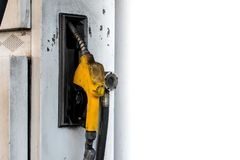 Isolated dirty yellow petrol pump filling nozzle on white backdrop, Gas station service. White background stock photography