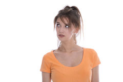 Isolated disappointed girl in orange shirt looking doubtful and Stock Photo