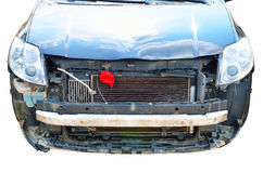Isolated dismantled front part of damaged car Royalty Free Stock Photo