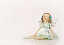 Isolated doll or puppet like a guardian angel. Stock Photos