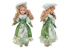 Isolated doll toy in green dress & hat. Royalty Free Stock Photo