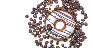 Isolated donut with a coffee beans Royalty Free Stock Photo