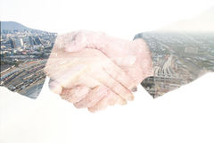 Isolated double exposure business handshake and construction Stock Photos
