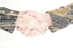 Isolated double exposure business handshake and construction Stock Photo