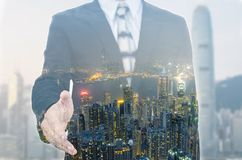 Businessman extending hand to shake with city scape. Royalty Free Stock Photos