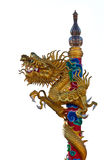 Isolated Dragon on a Post. A sculpture of a golden dragon that twist around a post in a chinese temple Royalty Free Stock Photography