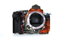 Isolated DSLR sectional view. It is a isolated sectional view of digital single lens reflex camera Stock Photos