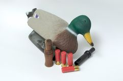 Isolated duck decoy, shotgun shells, and duck calls Stock Photography