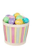 Isolated easter basket with colorful eggs Stock Photos
