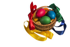 Isolated easter basket with colorful ribbons white background. Isolated Easter Wicker basket with pink vines painted chicken eggs on a white background Stock Photos