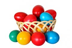 Isolated Easter eggs in different colors in a wooden basket Royalty Free Stock Photography