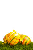 Isolated easter eggs on green grass Stock Images