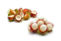 Isolated eating and eaten rambutan fruits Royalty Free Stock Image