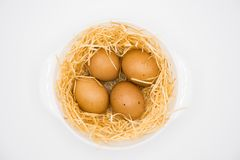 four eggs with nest stock images