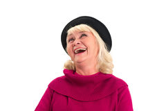 Isolated elderly female laughing. Cheerful woman looking up stock photo