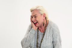 Isolated elderly lady laughing. Stock Photo