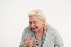 Isolated elderly woman laughing. Stock Image