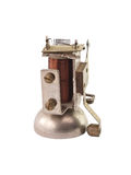 The isolated electric bell. The isolated, old, small disassembled electric bell Royalty Free Stock Image