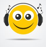 Isolated Emoticon with headphones in a flat design Stock Photos