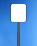 Isolated empty road sign. In sky for warning and information Royalty Free Stock Photo