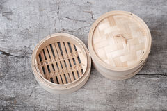 Isolated empty round steamer bamboo basket or crate Royalty Free Stock Image