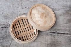 Isolated empty round steamer bamboo basket or crate Stock Photo