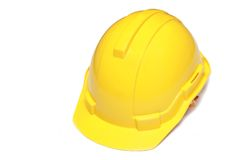 Isolated engineer hard hat. Isolated engineer yellow hard hat Stock Photography
