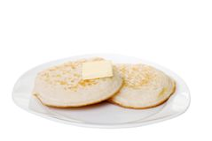 Isolated english crumpets with butter Stock Photography