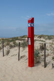 The isolated english word Sos on red sign to call on the beach Stock Images