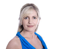 Isolated face of a beautiful middle aged blond woman in blue. Stock Photo