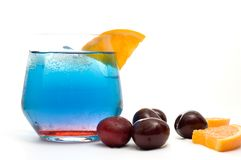 Isolated Fancy Blue Cocktail with Orange Slices and Cherries Stock Images