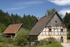 Isolated farmstead in forest Stock Photo