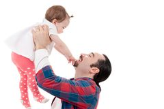 father picking up his daughter Isolated on white b Stock Images