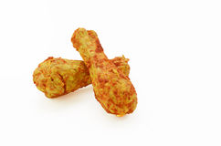 Isolated feeds with clipping path. Dogs feed in shape of chicken thigh royalty free stock photos