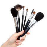 Isolated female hand with brushs for makeup Royalty Free Stock Image
