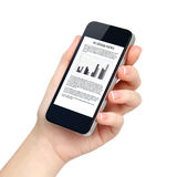 Isolated female hand holds the phone with business news on scree. Isolated female hand holds the phone tablet touch computer gadget with business news on screen Royalty Free Stock Image
