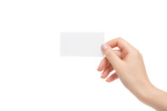 Isolated female hand holds white card on a white background. Female hand holds white card on a white background Royalty Free Stock Photo